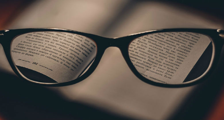 Reading a book through a reading glasses